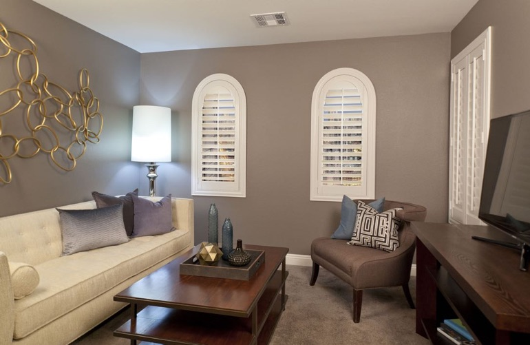 Boston family room with arch plantation shutters.