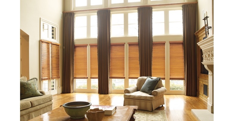 Boston great room with wooden blinds and floor to ceiling draperies.