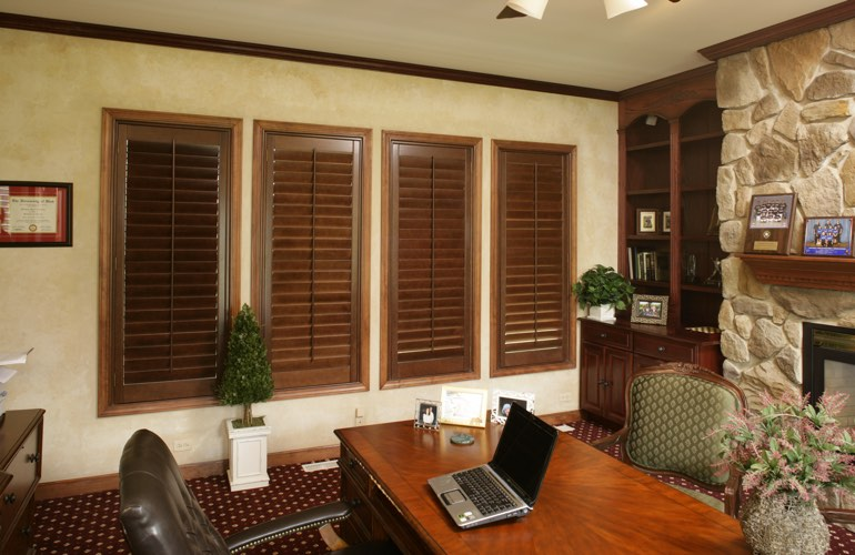 Wooden plantation shutters in a Boston home office