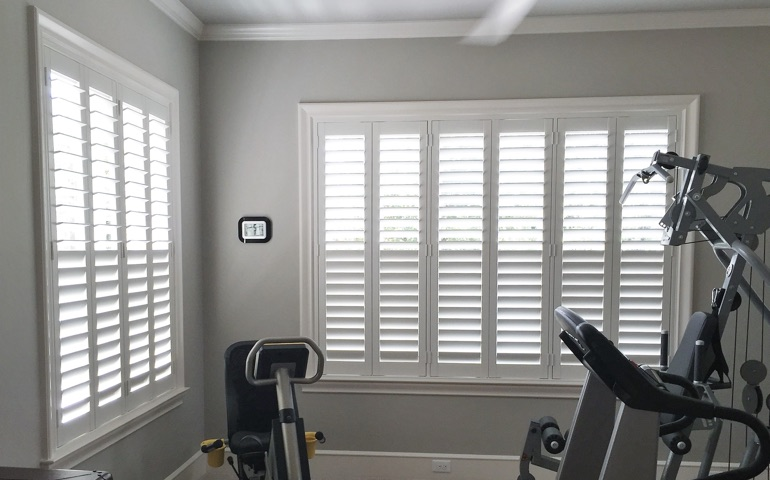 Boston fitness room with shuttered windows.