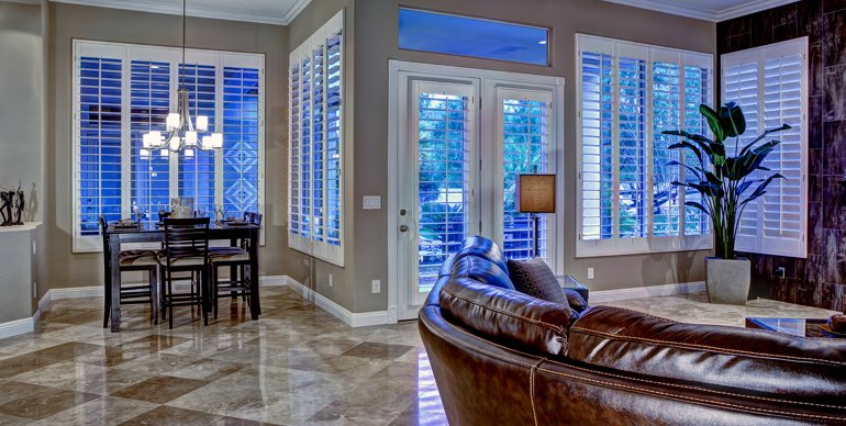 Boston Great Room With Clic Shutters And Leather Furniture