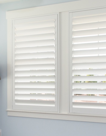 White plantation shutters with hidden tilt rods in Boston