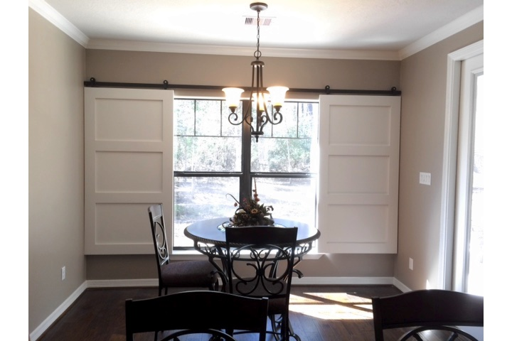 Boston dining room with sliding barn door shutters.