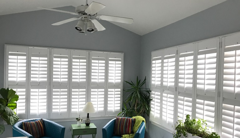 Boston living room with fan and shutters