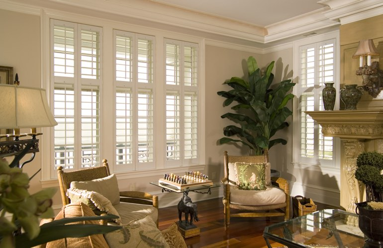 Living Room in Boston with interior plantation shutters.