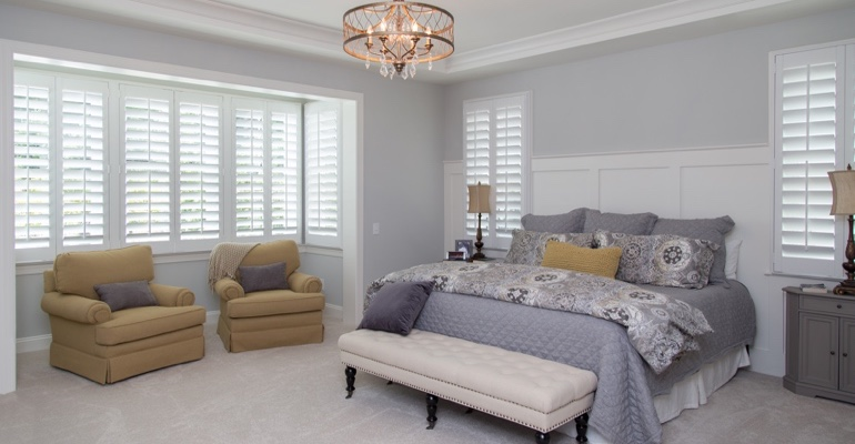 Plantation shutters in Boston bedroom.