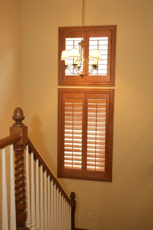 Ovation shutters in tan stairway.