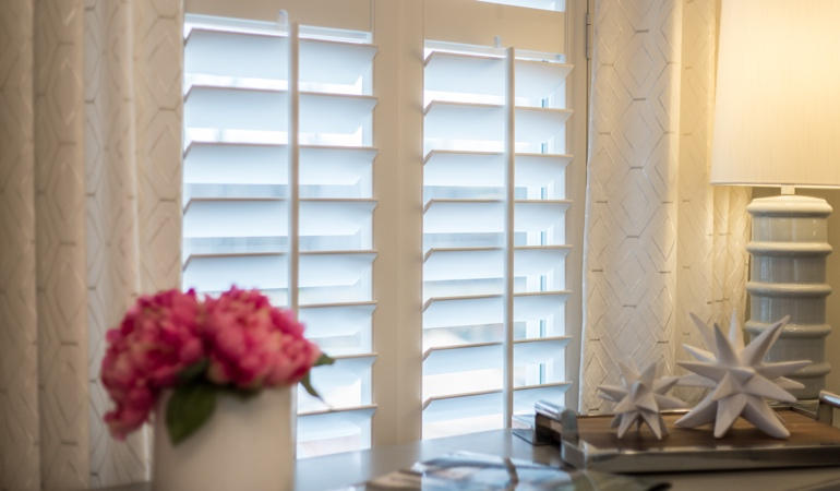 Plantation shutters by flowers in Boston