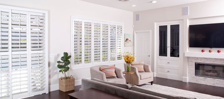 Boston living room in white with plantation shutters.