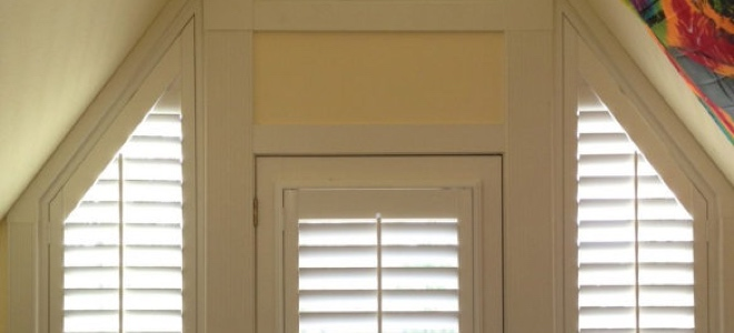 Slanted sidelights outside a door.