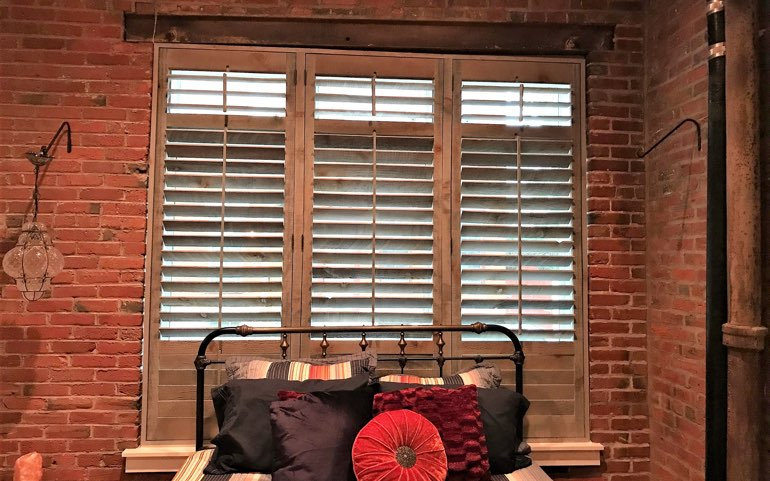 repurposed wood shutters in Boston apartment