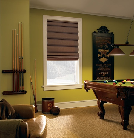 Roman shades in Boston rec room with green walls.