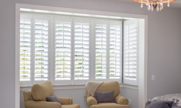 White shutters in Boston bay window