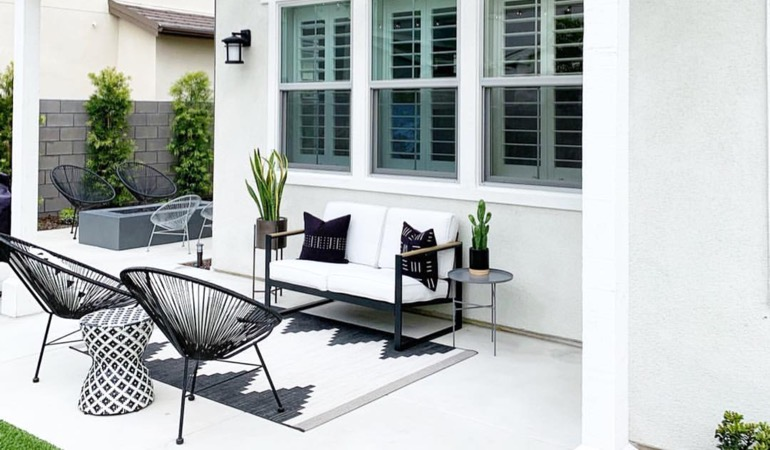 Backyard with plantation window treatments