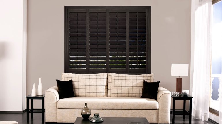 Boston sitting room with plantation shutters.