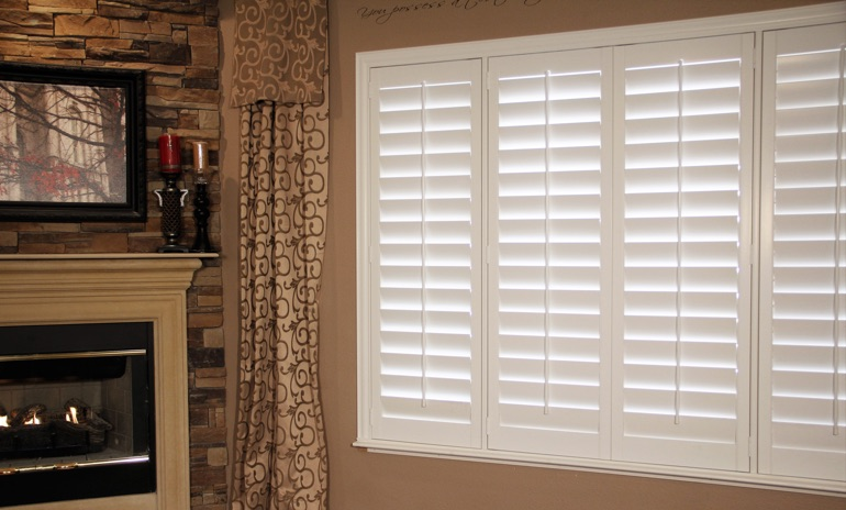 Boston Studio plantation shutters in family room.