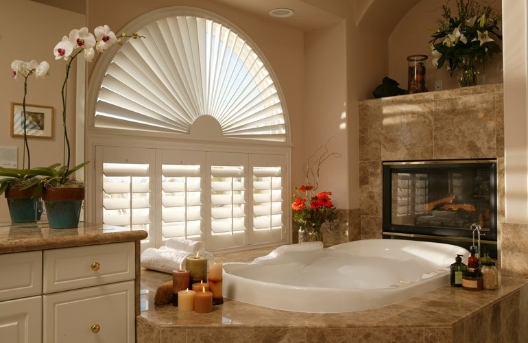 Arched shutters in a Boston bathroom.