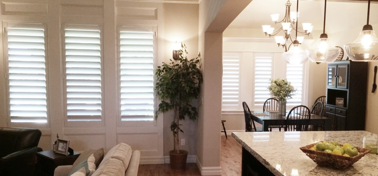 Boston shutters in dining room and living room