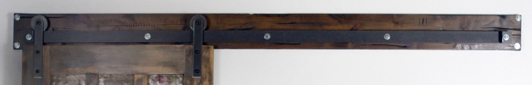 Dark brown track header for sliding barn doors