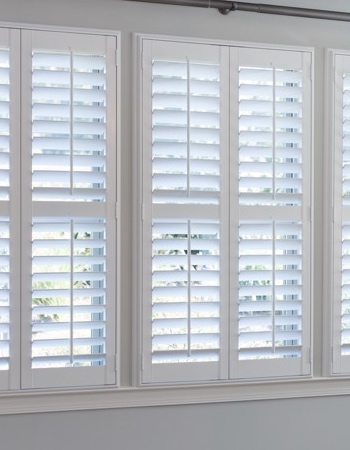 Hidden tilt rod shutters on Boston windows
