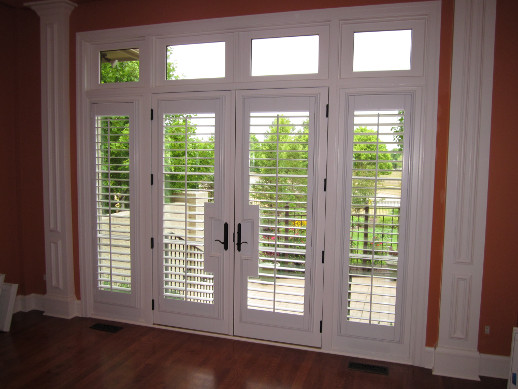 Boston patio door with sidelight shutters
