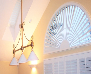 Boston arched eyebrow window with plantation shutter