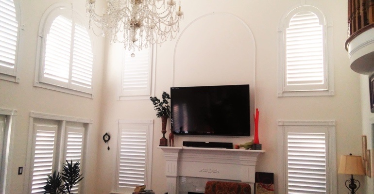 high ceiling windows with shutters Boston tv room