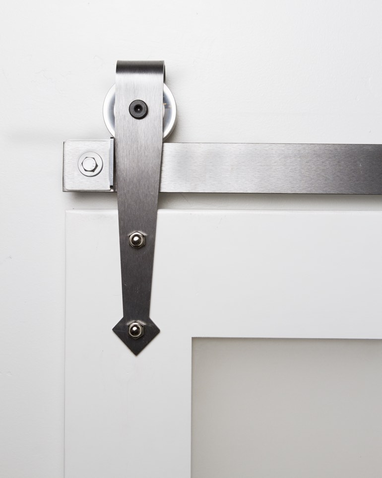 Stainless steel mini arrow hanger on white sliding barn door