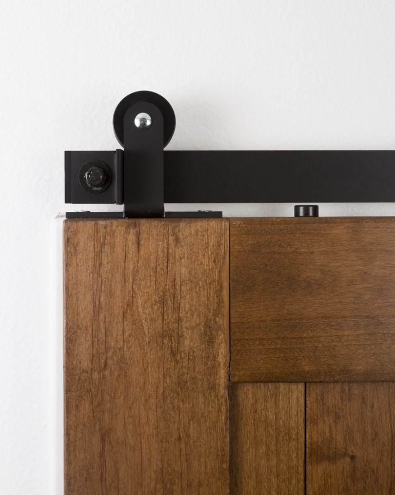 Black top-mounted mini modern hanger on sliding barn door