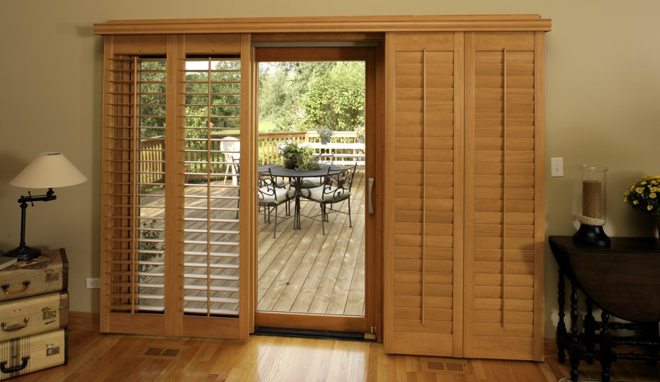 Wood bypass patio door shutters in Boston living room