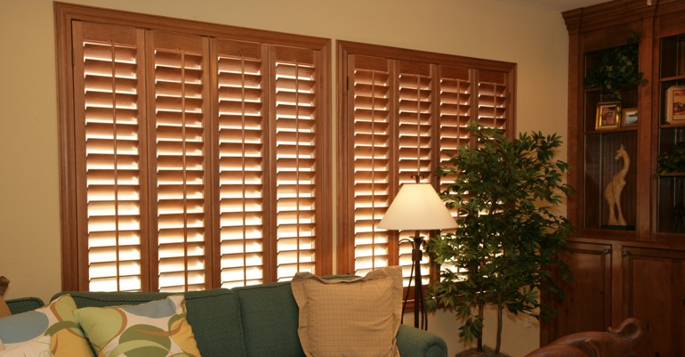 Hardwood shutters in Boston living room.