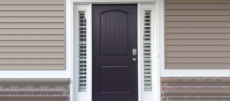 Entry Door Sidelight Shutters Next To Black Door In Boston, MA