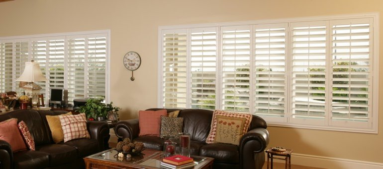Wide window with plantation shutters in Boston living room